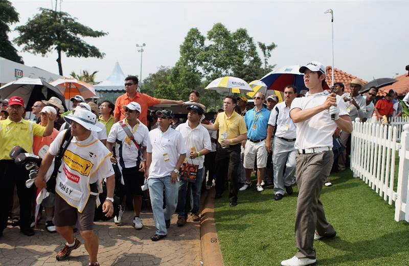 KUALA LUMPUR, MALAYSIA - MARCH 07:  Noh Seung-yul of Korea plays a fine third shot on the 18th hole on his way to victory in the Maybank Malaysian Open at the Kuala Lumpur Golf and Country Club on March 7, 2010 in Kuala Lumpur, Malaysia.  (Photo by Andrew Redington/Getty Images)