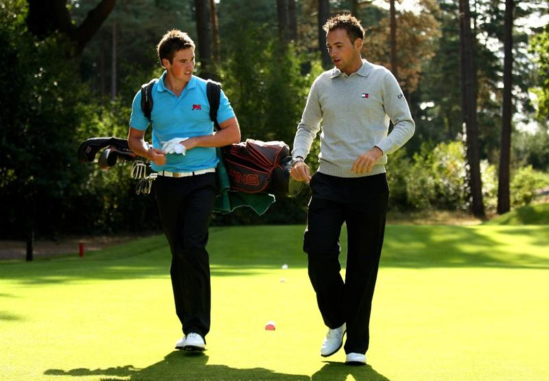 SUNNINGDALE, ENGLAND - SEPTEMBER 04:  Matt Haines of England (L) talks with former Walker Cup player and European Tour Pro Nick Dougherty of England during a GB&I Walker Cup practise round at Sunningdale Golf Club on September 4, 2009 in Sunningdale, England.  (Photo by Richard Heathcote/Getty Images)