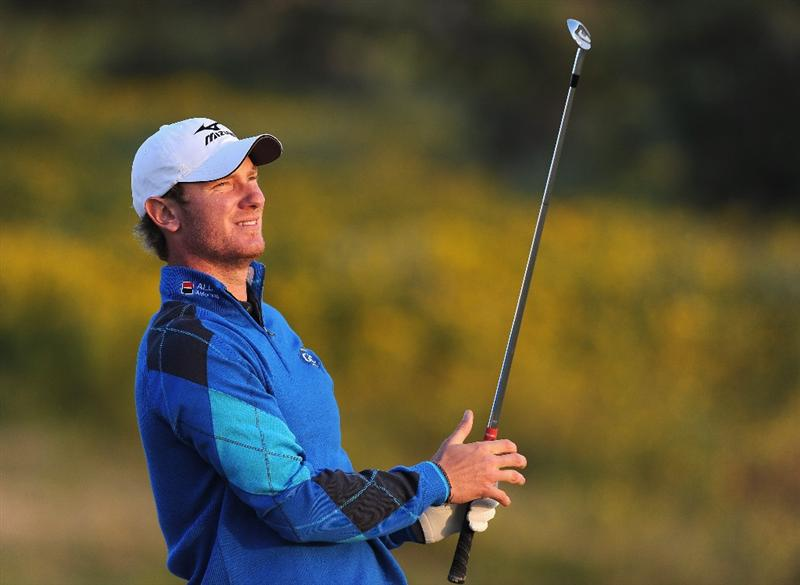 RAGUSA, ITALY - MARCH 18:  Chris Wood of England plays his approach shot on the 18th hole during the second round of the Sicilian Open at the Donnafugata golf resort and spa on March 18, 2011 in Ragusa, Italy.  (Photo by Stuart Franklin/Getty Images)
