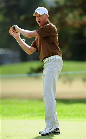 PARIS - SEPTEMBER 24:  Simon Dyson of the Great Britian and Northern Ireland team reacts to his putt on the 13th hole during his match against Soren  Hansen and Peter Hanson of the Continental Europe team during the first day fourball at The Vivendi Trophy with Severiano Ballesteros at Saint - Nom - La Breteche golf course on September 24, 2009 in Paris, France.  (Photo by Stuart Franklin/Getty Images)