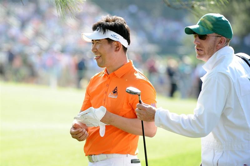AUGUSTA, GA - APRIL 07:  Y.E. Yang of South Korea reacts to his shot on the 17th hole alongside caddie during the first round of the 2011 Masters Tournament at Augusta National Golf Club on April 7, 2011 in Augusta, Georgia.  (Photo by Harry How/Getty Images)
