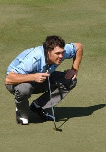 Eric Axley lines up a putt on the 18th green during a practice round at the 2006 Honda Classic March 7 at the Country Club at Mirasol in Palm Beach Gardens, Florida.Photo by Al Messerschmidt/WireImage.com