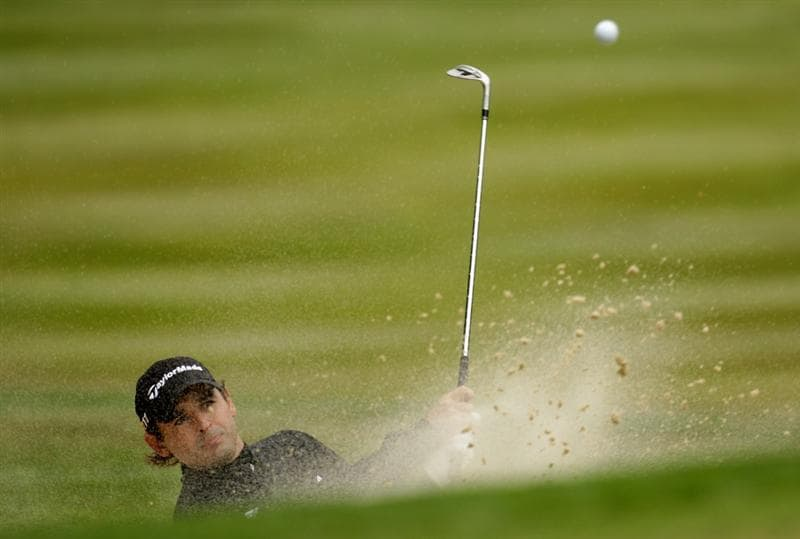 VIRGINIA WATER, ENGLAND - MAY 28:  Fabrizio Zanotti of Paraguay hits from a bunker on the 7th hole during the third round of the BMW PGA Championship at the Wentworth Club on May 28, 2011 in Virginia Water, England.  (Photo by Ross Kinnaird/Getty Images)