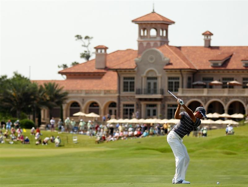 PONTE VEDRA BEACH, FL - MAY 12:  Charl Schwartzel of South Africa hits his approach shot on the 18th hole during the first round of THE PLAYERS Championship held at THE PLAYERS Stadium course at TPC Sawgrass on May 12, 2011 in Ponte Vedra Beach, Florida.  (Photo by Mike Ehrmann/Getty Images)