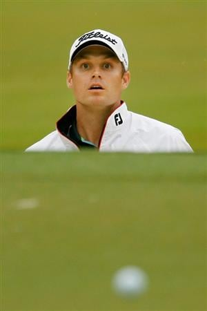 ATLANTA - SEPTEMBER 26:  Nick Watney watches his shot from a bunker on the 13th hole during the final round of THE TOUR Championship presented by Coca-Cola at East Lake Golf Club on September 26, 2010 in Atlanta, Georgia.  (Photo by Scott Halleran/Getty Images)