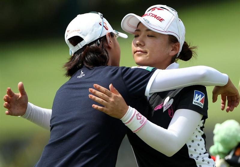 SINGAPORE - FEBRUARY 25:  Chie Arimura of Japan (right) embraces Na Yeon Choi of South Korea on the 18th hole during the second round of the HSBC Women's Champions at the Tanah Merah Country Club on February 25, 2011 in Singapore.  (Photo by Andrew Redington/Getty Images)