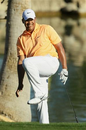 LA QUINTA, CA - JANUARY 23:  Jhonattan Vegas of Venezuela reacts after hitting a pitch shot to the 13th green during the final round of the Bob Hope Classic at the Palmer Private course at PGA West on January 23, 2011 in La Quinta, California.  (Photo by Jeff Gross/Getty Images)