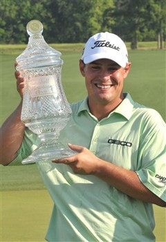 HUMBLE, TX - APRIL 06:  Johnson Wagner holds the winners trophy after winning  the final round of the Shell Houston Open at Redstone Golf Club April 6, 2008 in Humble, Texas.  (Photo by Marc Feldman/Getty Images)