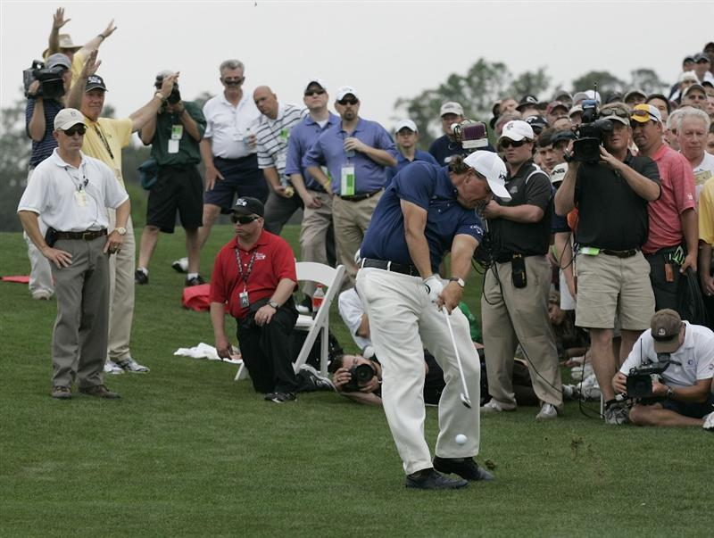 HUMBLE, TX - APRIL 03:  Phil Mickelson hits his second shot on the eighth hole during the final round of the Shell Houston Open at Redstone Golf Club on April 3, 2011 in Humble, Texas.  (Photo by Michael Cohen/Getty Images)