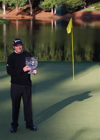AUGUSTA, GA - APRIL 08:  Tim Clark of South Africa poses with the winner's trophy after a 5-under par score to win the Par 3 Contest prior to the 2009 Masters Tournament at Augusta National Golf Club on April 8, 2009 in Augusta, Georgia.  (Photo by Andrew Redington/Getty Images)