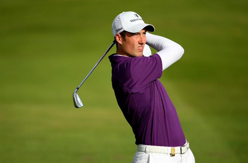 PERTH, UNITED KINGDOM - AUGUST 29:  Ross Fisher of England hits his second shot on the 13th hole during the second round of The Johnnie Walker Championship at Gleneagles on August 29, 2008 at the Gleneagles Hotel and Resort in Perthshire, Scotland.  (Photo by Andrew Redington/Getty Images)