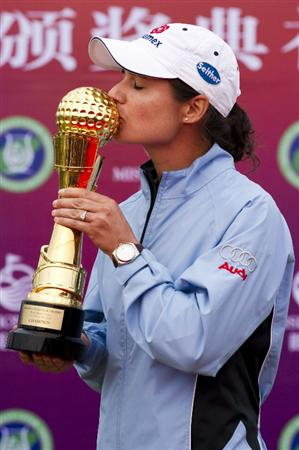 HAIKOU, CHINA - OCTOBER 31:  Lorena Ochoa of Mexico poses with the Mission Hills Start Trophy after winning the tournament at Mission Hills Resort on October 31, 2010 in Haikou, China. The Mission Hills Star Trophy is Asia's leading leisure liflestyle event and features Hollywood celebrities and international golf stars.  (Photo by Victor Fraile/Getty Images for Mission Hills)