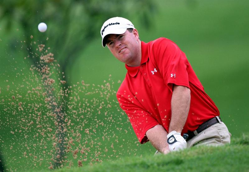 HONOLULU - JANUARY 16:  Robert Garrigus plays a shot from the bunker during the second round of the Sony Open at Waialae Country Club on January 16, 2009 in Honolulu, Hawaii.  (Photo by Sam Greenwood/Getty Images)