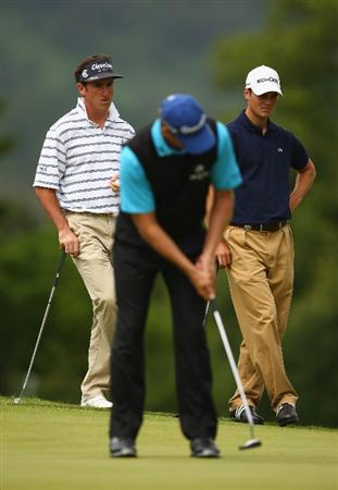 LUSS, SCOTLAND - JULY 12:  Gonzalo Fernandez-Castano of Spain and Martin Kaymer of Germany watch Retief Goosen of South Africa putt on the 4th green during the Final Round of The Barclays Scottish Open at Loch Lomond Golf Club on July 12, 2009 in Luss, Scotland.  (Photo by Richard Heathcote/Getty Images)