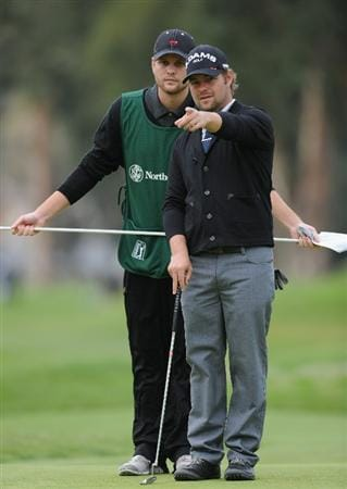 PACIFIC PALISADES, CA - FEBRUARY 18:  Ryan Moore and caddie ponder during the second round of the Northern Trust Open at Riviera Country Club on February 18, 2011 in Pacific Palisades, California.  (Photo by Stuart Franklin/Getty Images)