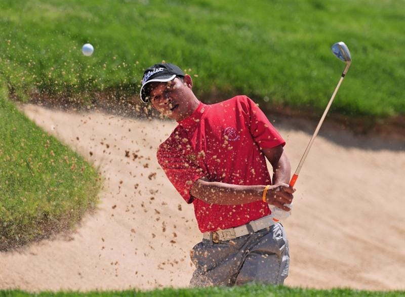 JEJU, SOUTH KOREA - APRIL 23:  Chawalit Plaphol of Thailand plays his bunker shot on the 13th hole during the first round of the Ballantine's Championship at Pinx Golf Club on April 23, 2009 in Jeju, South Korea.  (Photo by Stuart Franklin/Getty Images)