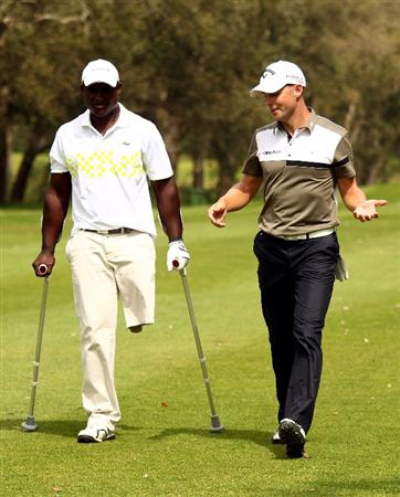 RABAT, MOROCCO - MARCH 18:  Manuel De Los Santos of the Dominican Republic talks with his playing partner, Niclas Fasth of Sweden (R) during the first round of the Hassan II Golf Trophy at Royal Golf Dar Es Salam on March 18, 2010 in Rabat, Morocco.  (Photo by Richard Heathcote/Getty Images)