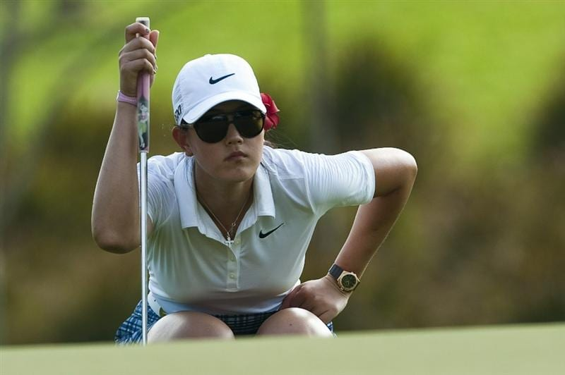 CHON BURI, THAILAND - FEBRUARY 18:  Michelle Wie of USA lines up a putt on the 17th green during day two of the LPGA Thailand at Siam Country Club on February 18, 2011 in Chon Buri, Thailand.  (Photo by Victor Fraile/Getty Images)