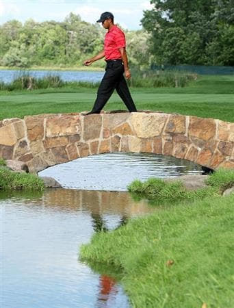 CHASKA, MN - AUGUST 16:  Tiger Woods walks over the bridge on the 16th hole during the final round of the 91st PGA Championship at Hazeltine National Golf Club on August 16, 2009 in Chaska, Minnesota.  (Photo by Streeter Lecka/Getty Images)