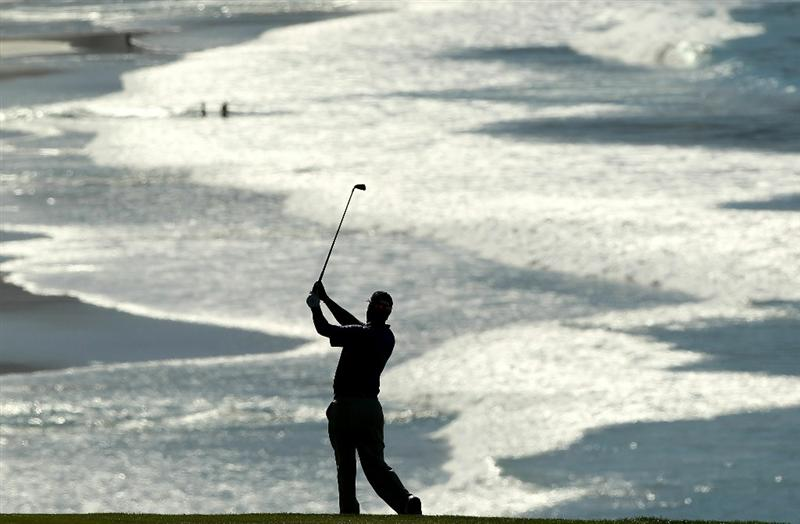 PEBBLE BEACH, CA - FEBRUARY 12:  Chris DiMarco hits his second shot on the 9th hole during the third round of the AT&T Pebble Beach National Pro-Am at the Pebble Beach Golf Links on February 12, 2011 in Pebble Beach, California.  (Photo by Ezra Shaw/Getty Images)
