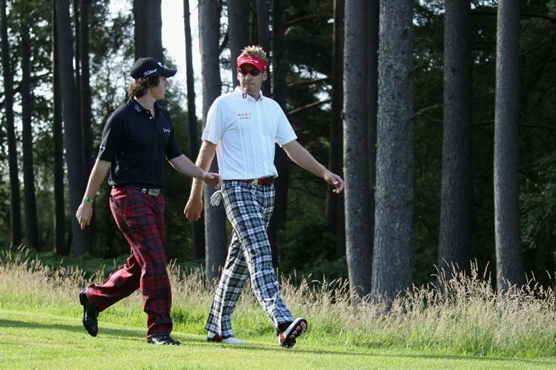 LUSS, SCOTLAND - JULY 09:  Rory McIlroy of Northern Ireland walks up the 13th fairway with Ian Poulter (R) of England during the First Round of The Barclays Scottish Open at Loch Lomond Golf Club on July 09, 2009 in Luss, Scotland.  (Photo by Warren Little/Getty Images)