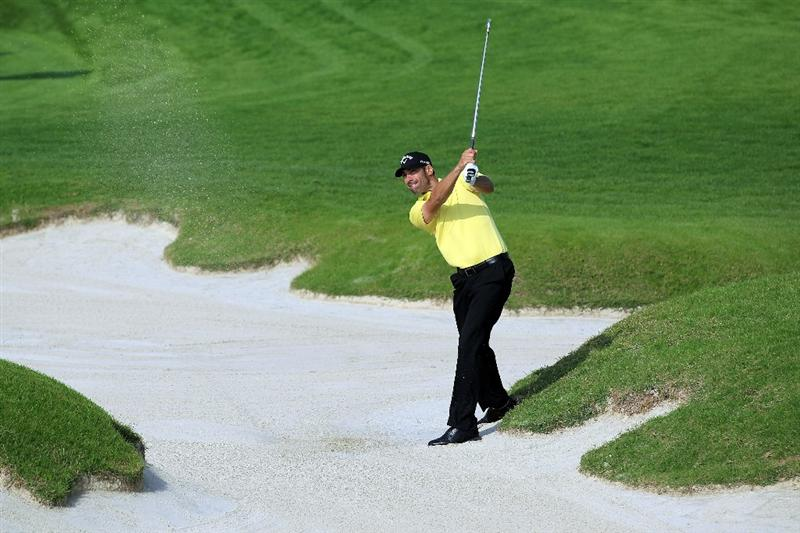 BAHRAIN, BAHRAIN - JANUARY 27:  Alvaro Quiros of Spain plays his second shot at the 17th hole during the first round of the 2011 Volvo Champions held at the Royal Golf Club on January 27, 2011 in Bahrain, Bahrain.  (Photo by David Cannon/Getty Images)