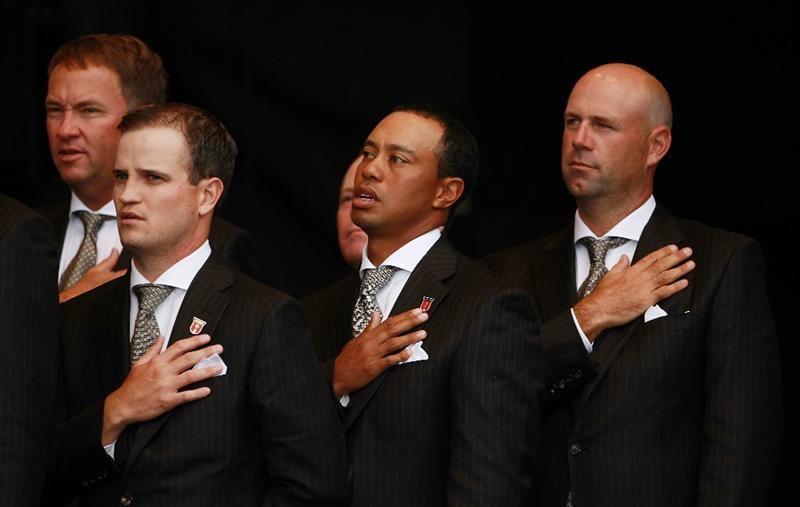 NEWPORT, WALES - SEPTEMBER 30:  Zach Johnson (L) , Tiger Woods and Stewart Cink of the USA (R) stand for their national anthem during the Opening Ceremony prior to the 2010 Ryder Cup at the Celtic Manor Resort on September 30, 2010 in Newport, Wales.  (Photo by Andrew Redington/Getty Images)