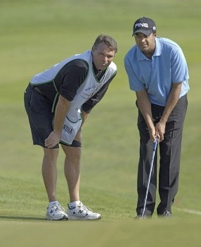 Arjun Atwal of India talks over a putt with his caddie during the first round of the 2005 Algarve World Cup at the Victoria Golf Club in Vilamoura, Portugal on November 17, 2005.Photo by Sandy Young/WireImage.com