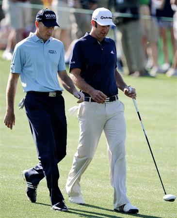 AUGUSTA, GA - APRIL 04:  Jim Furyk (L) and Dustin Johnson walk down a fairway during a practice round prior to the 2011 Masters Tournament at Augusta National Golf Club on April 4, 2011 in Augusta, Georgia.  (Photo by Harry How/Getty Images)