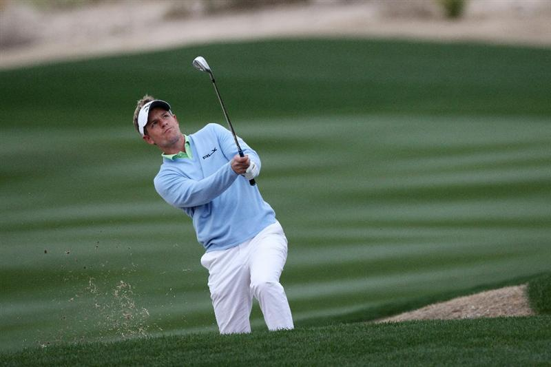 MARANA, AZ - FEBRUARY 26:  Luke Donald of England hits an approach shot on the second hole during the quarterfinal round of the Accenture Match Play Championship at the Ritz-Carlton Golf Club on February 26, 2011 in Marana, Arizona.  (Photo by Sam Greenwood/Getty Images)