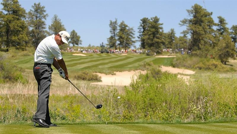 PARKER, CO. - MAY 29: Chien Soon Lu of Taiwan tees off the eighth hole during the third round of the Senior PGA Championship at the Colorado Golf Club on May 29, 2010 in Parker, Colorado.  (Photo by Marc Feldman/Getty Images)