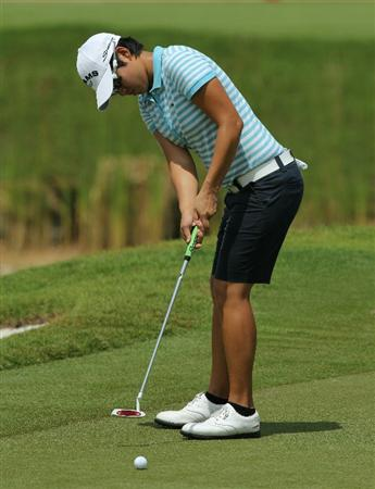 KUALA LUMPUR, MALAYSIA - OCTOBER 22 : Yani Tseng of Taiwan putts on the 3rd hole during Round One of the Sime Darby LPGA on October 22, 2010 at the Kuala Lumpur Golf and Country Club in Kuala Lumpur, Malaysia. (Photo by Stanley Chou/Getty Images)