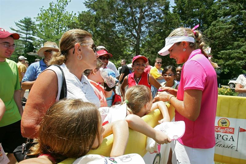 GALLOWAY, NJ - JUNE 19:  Alexis Thompson (R) signs autographs for fans during the second round of the ShopRite LPGA Classic held at Dolce Seaview Resort (Bay Course) on June 19, 2010 in Galloway, New Jersey.  (Photo by Michael Cohen/Getty Images)