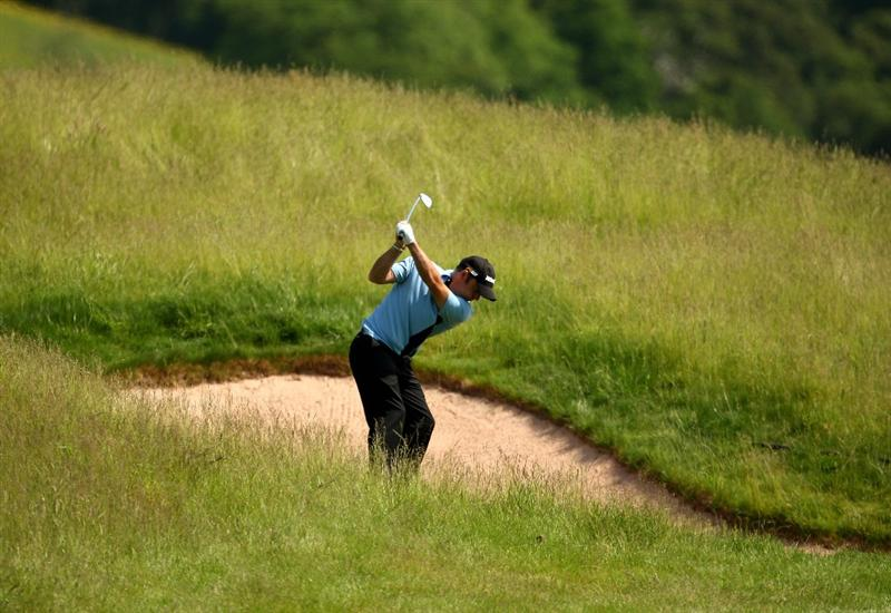 NEWPORT, WALES - JUNE 04:  Paul McGinley of Ireland plays into the 2nd green during the first round of the Celtic Manor Wales Open on the 2010 Course at The Celtic Manor Resort on June 4, 2009 in Newport, Wales.  (Photo by Richard Heathcote/Getty Images)