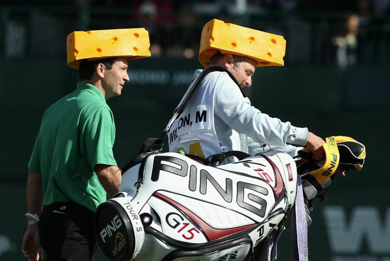 SCOTTSDALE, AZ - FEBRUARY 06:  Mark Wilson and caddie Chris P. Jones walk down the 16th hole wearing Green Bay Packers cheese heads during the third round of the Waste Management Phoenix Open at TPC Scottsdale on February 6, 2011 in Scottsdale, Arizona.  (Photo by Christian Petersen/Getty Images)