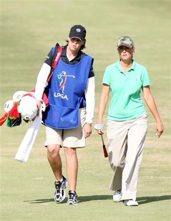 DAYTONA BEACH, FL - DECEMBER 04:  LPGA Tour member Wendy Ward caddies for fellow member Vicki Goetze-Ackerman during the second round of the LPGA Qualifying School at LPGA International on December 4, 2008 in Daytona Beach, Florida.  (Photo by Sam Greenwood/Getty Images)