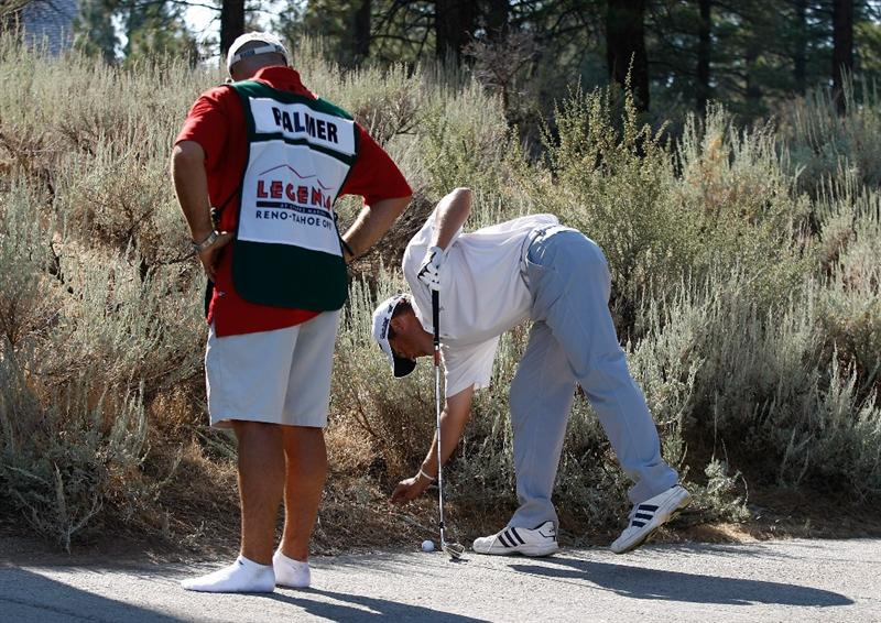 RENO, NV - AUGUST 08:  Ryan Palmer wearing his caddie's, James Edmondson, tennis shoes, looks at his ball just off the cart path during the third round of the Legends Reno-Tahoe Open on August 8, 2009 at Montreux Golf and Country Club in Reno, Nevada.  (Photo by Jonathan Ferrey/Getty Images)