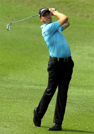 HONG KONG - NOVEMBER 19: Soren hansen of Denmark plays his 2nd shot on the 3rd hole during day two of the UBS Hong Kong Open at The Hong Kong Golf Club on November 19, 2010 in Hong Kong, Hong Kong. ( Photo by Stanley Chou/Getty Images )