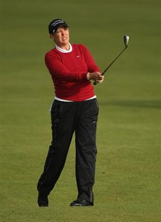 LYTHAM ST ANNES, ENGLAND - JULY 30:  Cristie Kerr of USA hits her second shot on the 2nd hole during the first round of the 2009 Ricoh Women's British Open Championship held at Royal Lytham St Annes Golf Club, on July 30, 2009 in  Lytham St Annes, England.  (Photo by Warren Little/Getty Images)
