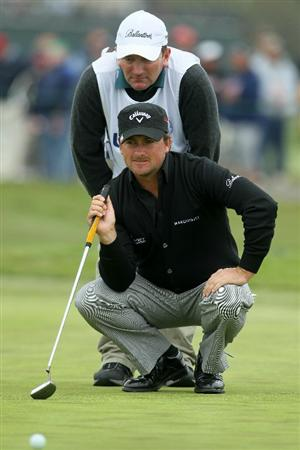 PEBBLE BEACH, CA - JUNE 18:  Graeme McDowell of Northern Ireland lines up a putt with his caddie Ken Comboy during the second round of the 110th U.S. Open at Pebble Beach Golf Links on June 18, 2010 in Pebble Beach, California.  (Photo by Jeff Gross/Getty Images)