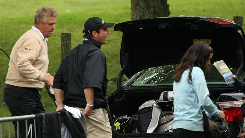 PERTH, UNITED KINGDOM - AUGUST 31:  Colin Montgomerie of Scotland and his caddie Jason Hempleman pack his car as he departs after the final round of The Johnnie Walker Championship at Gleneagles on August 31, 2008 at the Gleneagles Hotel and Resort in Perthshire, Scotland.  (Photo by Ross Kinnaird/Getty Images)