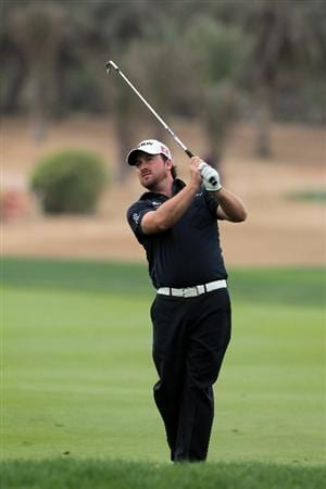 ABU DHABI, UNITED ARAB EMIRATES - JANUARY 21:  Graeme McDowell of Northern Ireland plays his second shot on the 9th hole during the second round of the 2011 Abu Dhabi HSBC Golf Championship held at the Abu Dhabi Golf Club on January 21, 2011 in Abu Dhabi, United Arab Emirates.  (Photo by David Cannon/Getty Images)