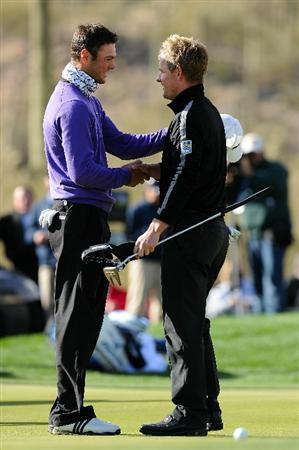 MARANA, AZ - FEBRUARY 27:  (L-R) Martin Kaymer of Germany congratulates Luke Donald of England on his victory on the 16th hole during the final round of the Accenture Match Play Championship at the Ritz-Carlton Golf Club on February 27, 2011 in Marana, Arizona.  (Photo by Stuart Franklin/Getty Images)