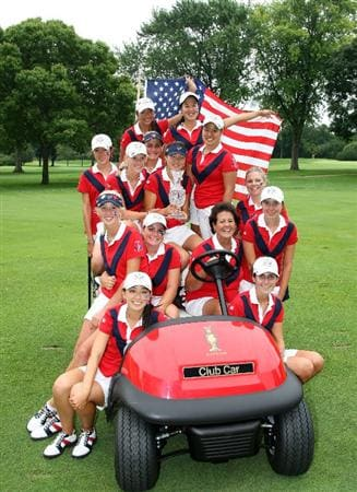 AURORA, IL - AUGUST 19:  The victorious USA team led by captain Nancy Lopez with the trophy at the end of the matches on the final day of the 2009 Junior Solheim Cup Matches, at the Aurora Country Club on August 19, 2009 in Aurora, Ilinois  (Photo by David Cannon/Getty Images)