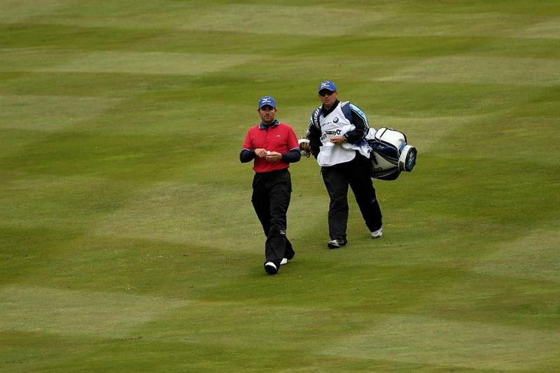 VIRGINIA WATER, ENGLAND - MAY 26:  Ignacio Garrido of Spain walks with his caddie on the fourth hole during the first round of the BMW PGA Championship at Wentworth Club on May 26, 2011 in Virginia Water, England.  (Photo by Andrew Redington/Getty Images)