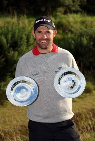KINGSBARNS, UNITED KINGDOM - OCTOBER 02:  Padraig Harrington of Ireland poses with European Tour Golfer of the Month  July and August trophies after the first round of The Alfred Dunhill Links Championship at Kingsbarns Golf Links on October 2, 2008 in Kingbarns, Scotland.  (Photo by Ross Kinnaird/Getty Images)