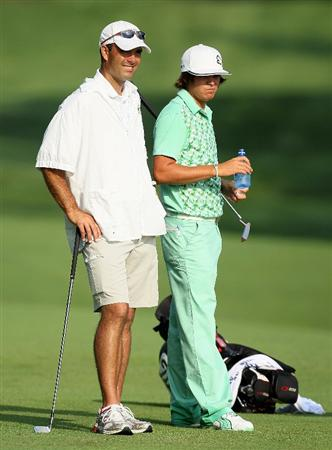 DUBLIN, OH - JUNE 04:  Rickie Fowler (right) is pictured with Ohio State Golf Coach Donnie Darr on the 13th hole during the second round of The Memorial Tournament presented by Morgan Stanley at Muirfield Village Golf Club on June 4, 2010 in Dublin, Ohio. Darr is the caddy for Fowler this week. (Photo by Andy Lyons/Getty Images)