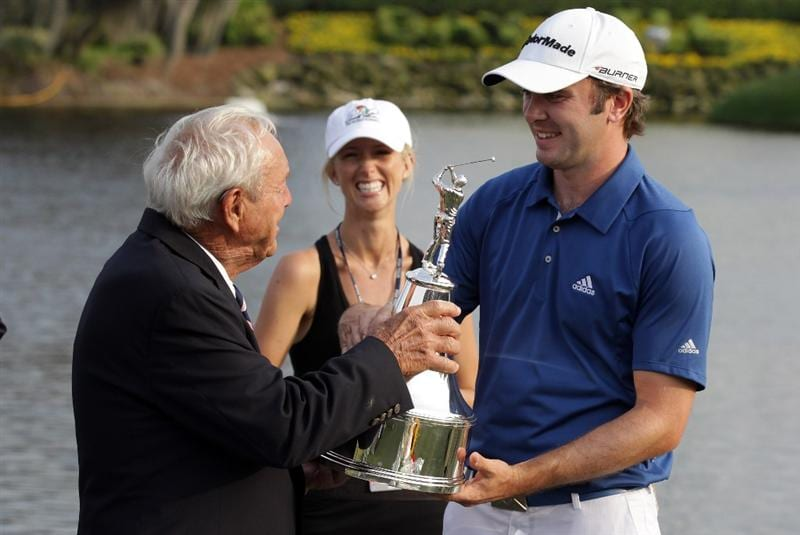 ORLANDO, FL - MARCH 27:  Martin Laird of Scotland is presented with the trophy by Arnold Palmer as Laird's fiancee Megan Franks looks on behind after the final round of the 2011 Arnold Palmer Invitational presented by Mastercard at the Bay Hill Lodge and Country Club on March 27, 2011 in Orlando, Florida.  (Photo by David Cannon/Getty Images)