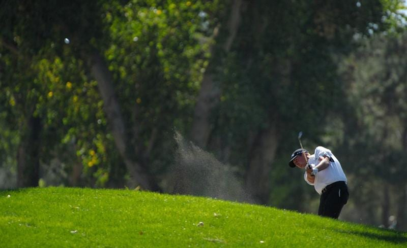 SAN JACINTO, CA - OCTOBER 02: Brian Stuard makes a shot out of a bunker on the 18th hole during the second round of the 2009 Soboba Classic at The Country Club at Soboba Springs on October 2, 2009 in San Jacinto, California.  (Photo by Robert Laberge/Getty Images)