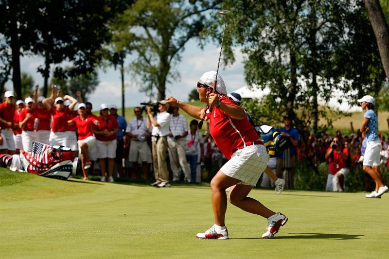 SUGAR GROVE, IL - AUGUST 23:  Christina Kim of the U.S. Team celebrates after sinking a putt on the 16th green during  the 2009 Solheim Cup at Rich Harvest Farms on August 23, 2009 in Sugar Grove, Illinois.  (Photo by Chris Graythen/Getty Images)